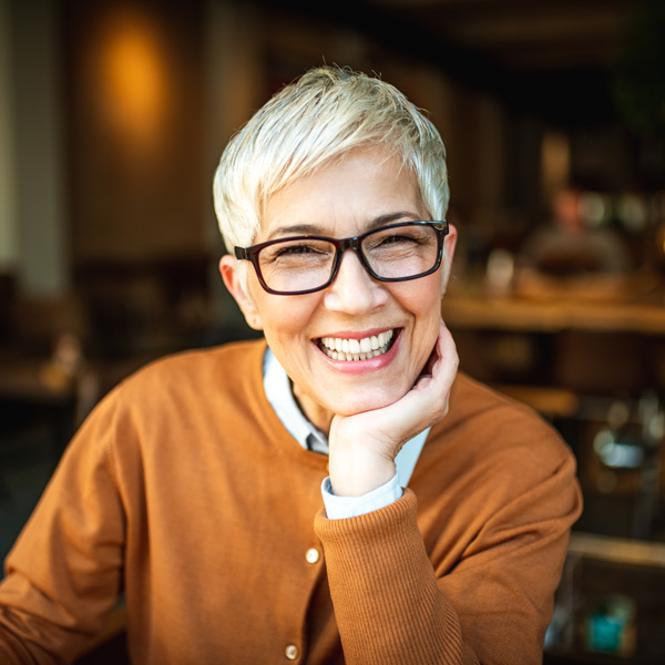 mature woman in glasses smiling